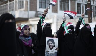 **FILE** Protestors chant slogans during a rally Sept. 18, 2012, in Sanaa, Yemen, to commemorate the one-year anniversary of the people who were killed in clashes with Yemeni government forces. (Associated Press)