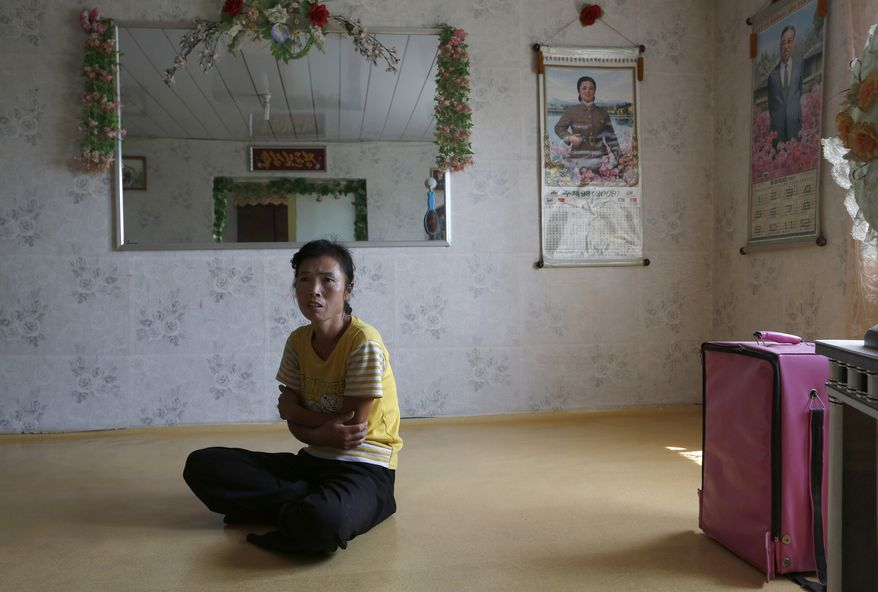 North Korean farmer O Yong-ae is interviewed at her home at the Migok Cooperative Farm in Sariwon, in North Korea's Hwanghae province, on Sunday, Sept. 23, 2012. (AP Photo/Vincent Yu)