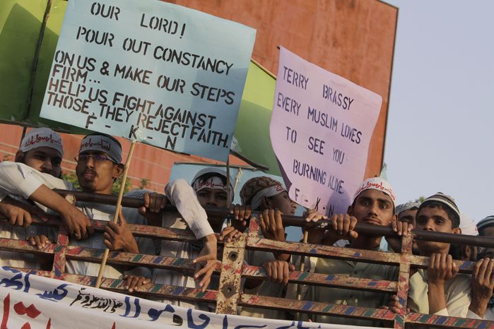 Supporters of a Pakistani religious group demonstrate against a film ridiculing Islam's Prophet Muhammad in Lahore, Pakistan, on Sunday, Sept. 23, 2012. (AP Photo/K.M. Chaudary)
