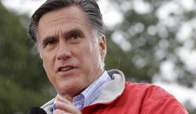 **FILE** Republican presidential candidate Mitt Romney campaigns Sept. 14, 2012, in the rain at Lake Erie College in Painesville, Ohio. (Associated Press)