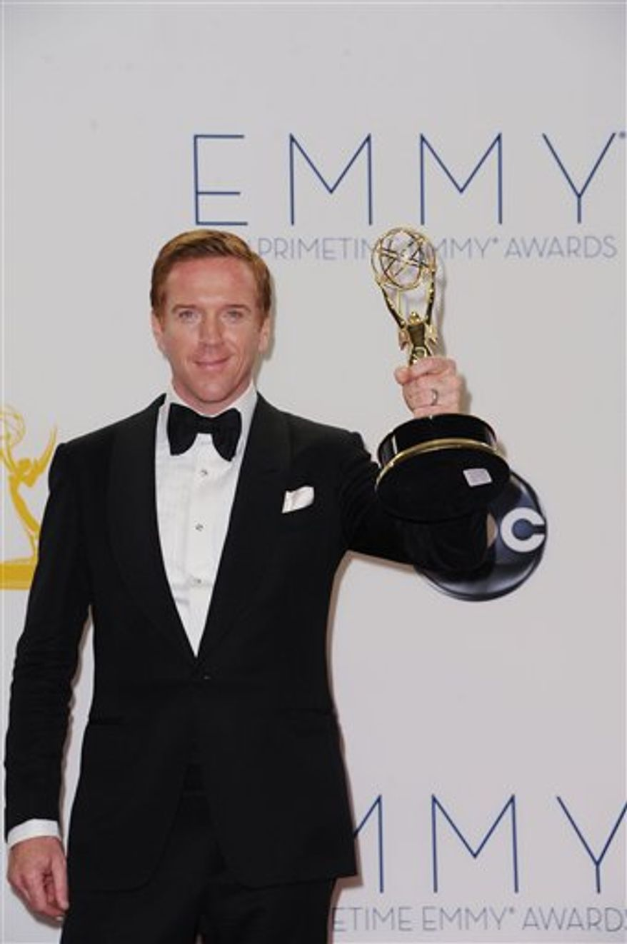 Damian Lewis poses for a photo at The 64th Annual Primetime Emmy Awards Winners Walk, Sunday, September 23, 2012, at LA Live, in Los Angeles. Lewis won the best actor award for his performance in Showtime's 'Homeland.' (Associated Press)