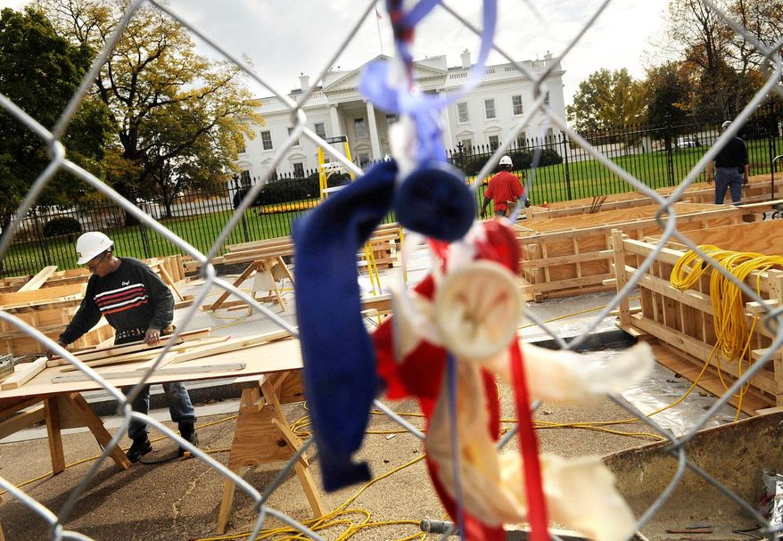 Doug Riley with Associated Builders Inc., works in November 2008 to build a presidential reviewing stand in front of the White House at 1600 Pennsylvania Avenue. The District is starting to prepare for the Jan. 21 Inauguration. (Rod Lamkey Jr./The Washington Times)
