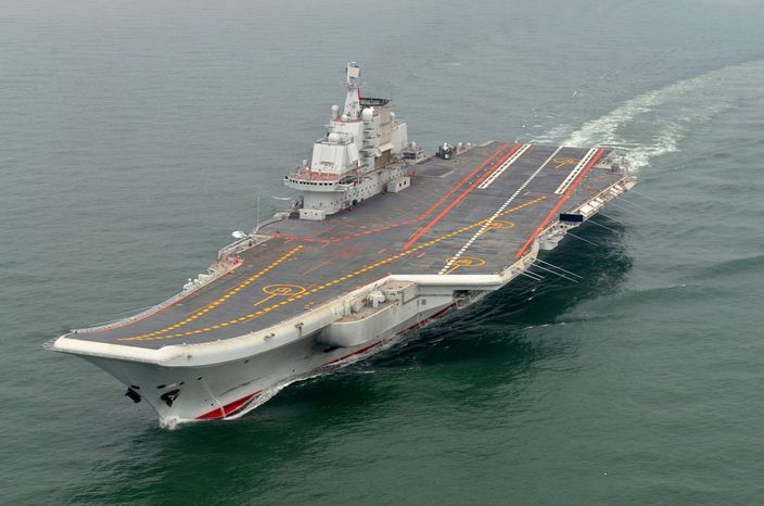 The Chinese aircraft carrier Liaoning takes a test cruise in May 2012. China formally entered the vessel, its first aircraft carrier, into service on Tuesday, Sept. 25, 2012, underscoring the nation's ambitions to be a leading Asian na