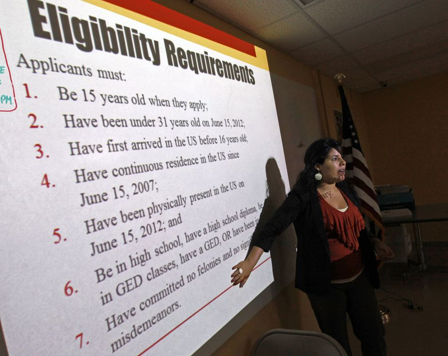 Charlene Gomez conducts an orientation seminar for illegal immigrants at the Coalition for Humane Immigrant Rights of Los Angeles (CHIRLA) on Thursday, Sept. 20, 2012, to help determine if they qualify for temporary work permits. (AP Photo/Reed Saxon)