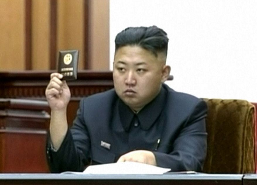 In this image taken from television, North Korean leader Kim Jong-un holds up his credential at the second meeting of the year of the Supreme People's Assembly in Pyongyang, North Korea, on Tuesday, Sept. 25, 2012. The parliament passed a law that adds one year of compulsory education for children in the socialist nation, the first publicly-announced policy change under Mr. Kim. (AP Photo/KRT via AP video)