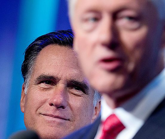Former President Bill Clinton (right) introduces Republican presidential candidate Mitt Romney at the Clinton Global Initiative meeting in New York on Tuesday, Sept. 25, 2012. (AP Photo/Evan Vucci)