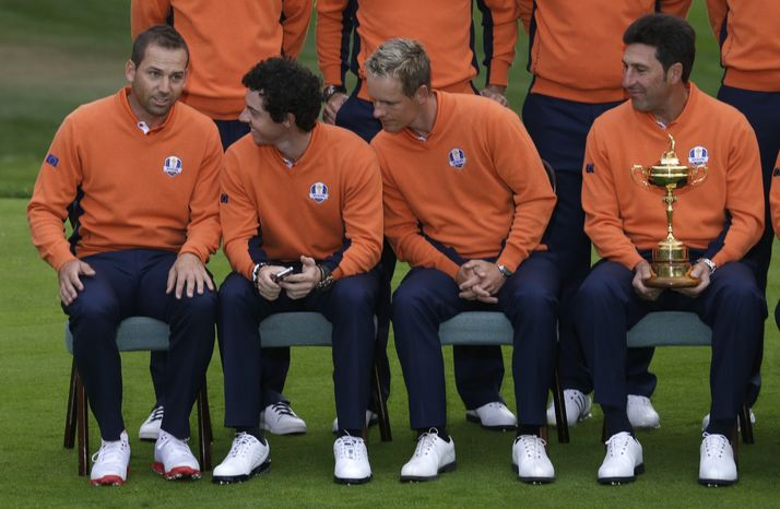 Europe's Sergio Garcia, left to right, Rory McIlroy, Luke Donald and captain Jose Maria Olazabal wait for the team picture during the Ryder Cup PGA golf tournament Tuesday, Sept. 25, 2012, at the Medinah Country Club in Medinah, Ill. (AP Photo/David J. Phillip)