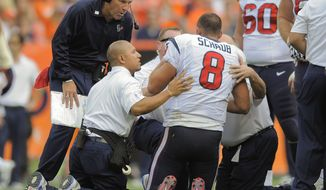 Houston Texans quarterback Matt Schaub (8) is checked by coach Gary Kubiak and trainers after taking a hit in the third quarter of an NFL football game against the Denver Broncos Sunday, Sept. 23, 2012, in Denver. (AP Photo/Jack Dempsey)