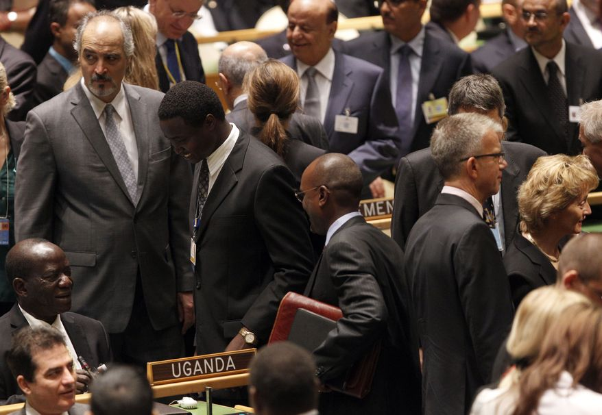 Syrian Ambassador to the United Nations Bashar Al-Jaafari (left) arrives for the 67th session of the United Nations General Assembly at U.N. headquarters on Sept. 25, 2012. (Associated Press)
