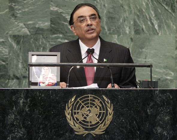 Asif Ali Zardari, President of Pakistan, addresses the 67th session of the United Nations General Assembly with a photo of Pakistan's late Prime Minister Benazir Bhutto next to him at U.N. headquarters Tuesday, Sept. 25, 2012. (AP Photo/Frank Franklin II)