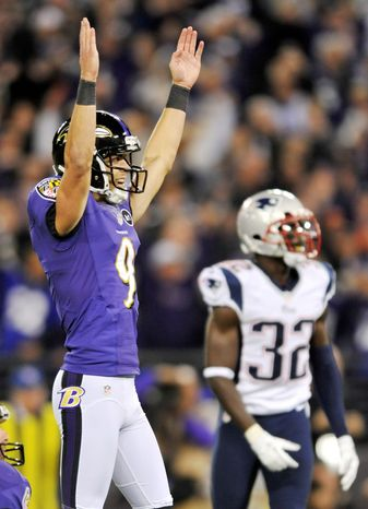 Ravens rookie kicker Justin Tucker signals his game-winning field goal against the Patriots on Sunday night as Devin McCourty looks on. (Associated Press)