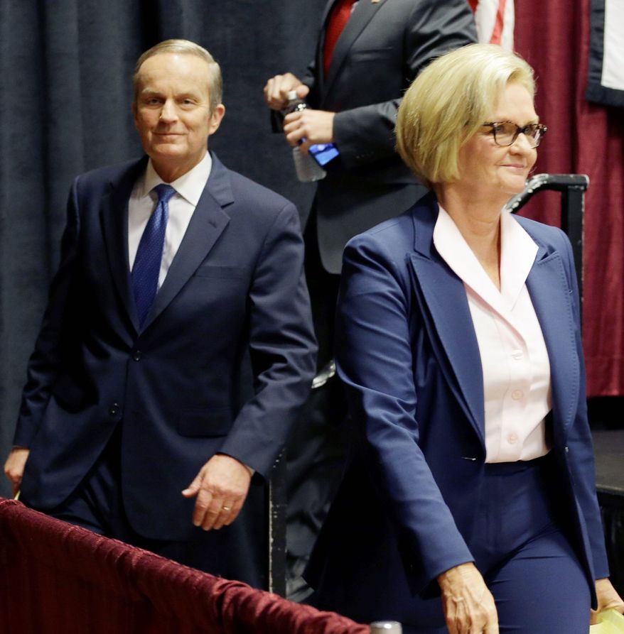 Democratic Sen. Claire McCaskill walks off the stage with challengers Republican W. Todd Akin (left) and Libertarian Jonathan Dine after their debate in the Missouri Senate race in Columbia, Mo., on Sept. 21. (Associated Press)