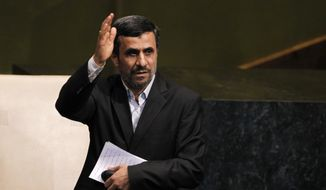 Iranian President Mahmoud Ahmadinejad waves after addressing the 67th session of the U.N. General Assembly at the world body's headquarters on Wednesday, Sept. 26, 2012. (AP Photo/Jason DeCrow)
