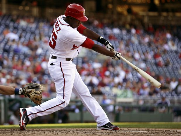 Washington Nationals' Eury Perez (55) bats during a baseball game against the Milwaukee Brewers at Nationals Park Monday, Sept. 24, 2012, in Washington. The Nationals won 12-2. (AP Photo/Alex Brandon)