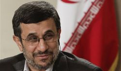 ** FILE ** Iranian President Mahmoud Ahmadinejad speaks during an exclusive interview with Associated Press editorial staff during his visit to the 67th session of the United Nations General Assembly on Tuesday, Sept. 25, 2012, in New York. (AP Photo/Bebeto Matthews)