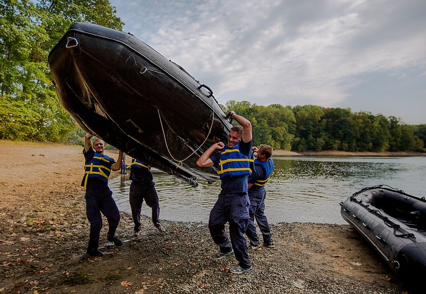 River Town New Jersey Officers lift a raft over their heads as they prepare to run it up a hill at the Iron Team Endurance Competition in Laurel, MD., Wednesday, September 26, 2012. This competition is hosted by the Prince George's County Police where teams from all over the east coast, including the Marines, compete in a grueling physical endurance challenge.(Andrew S. Geraci/The Washington Times)