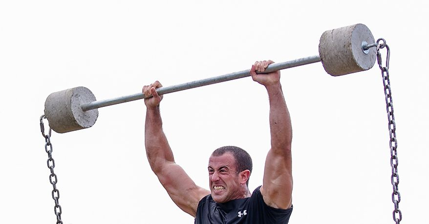 Officer Rob Lang, assigned to Metro Transit in Washington D.C., lifts cement blocks with chains at Iron Team Endurance Competition in Laurel, MD., Wednesday, September 26, 2012. The competition is hosted by the Prince George's County Police where teams from all over the east coast, including the Marines, compete in a grueling physical endurance challenge.(Andrew S. Geraci/The Washington Times)