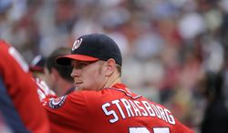Washington Nationals starting pitcher Stephen Strasburg watches from the dugout during the eighth inning of their baseball game against the Atlanta Braves at Turner Field Saturday, Sept. 15, 2012, in Atlanta.    (AP Photo/David Tulis)