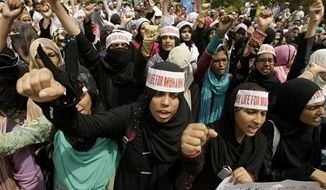 Pakistani students chant anti-U.S. slogans at a rally to protest against the making of a blasphemous film by a U.S. filmmaker at Karachi university on Wednesday, Sept. 26, 2012, in Pakistan. A Pakistani Taliban spokesman says the militant group has announced an amnesty for a minister who offered a $100,000 bounty for anyone who kills the maker of an anti-Islam film. (AP Photo/Fareed Khan)