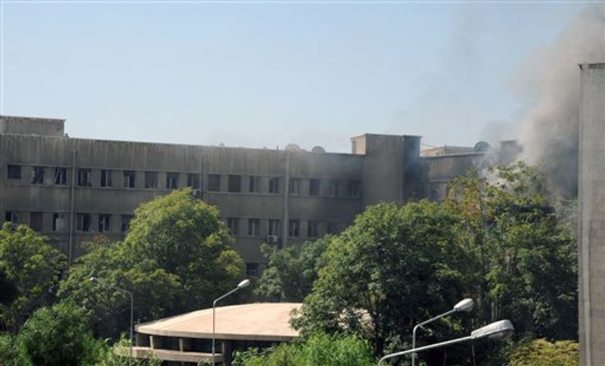 This photo released by the Syrian official news agency SANA, shows smoke rising from Syria's army command headquarters in Damascus, Syria,Wednesday, Sept. 26, 2012. Twin blasts targeting Syria's army command headquarters rocked the capital on Wednesday, setting off hours of sporadic gunbattles and a raging fire inside the heavily guarded compound, state-run media and witnesses said. (AP Photo/SANA)