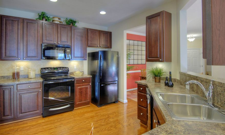 The kitchen in the Chambord features cherry cabinets and granite counters.