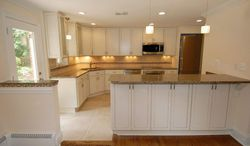 The newly renovated kitchen features stainless steel appliances, maple cabinets and plenty of space for two cooks to share.