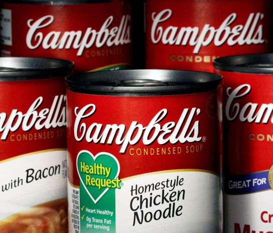 Cans of Campbell's soup are seen in Moreland Hills, Ohio. Campbell Soup Co. announced Thursday, Sept. 27, 2012, that it will be closing two U.S. plants and cutting more than 700 jobs as it looks to trim costs amid declining canned soup consumption. (Associated Press)
