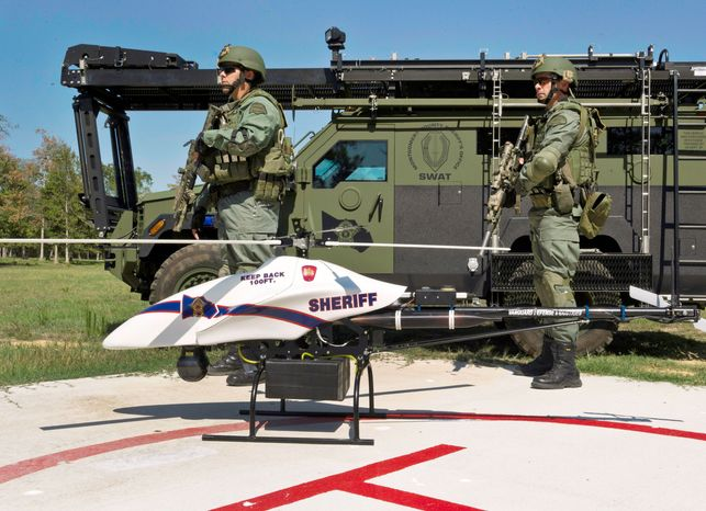 Drones are considered efficient tools for law enforcement, but a third of Americans worry that their privacy will suffer if the unmanned devices are used regularly in U.S. skies, according to a poll. Congress has directed the Federal Aviation Administration to come up with safety regulations to clear the way for routine domestic use of the aircraft within three years. (Vanguard Defense Industries via Associated Press)
