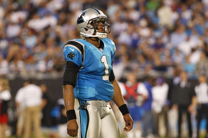 Carolina Panthers' Cam Newton (1) reacts during the third quarter of an NFL football game against the New York Giants in Charlotte, N.C., Thursday, Sept. 20, 2012. (AP Photo/Chuck Burton)