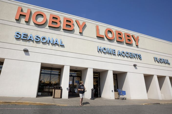 ** FILE ** A woman leaves a Hobby Lobby store in Little Rock, Ark., on Sept. 12,