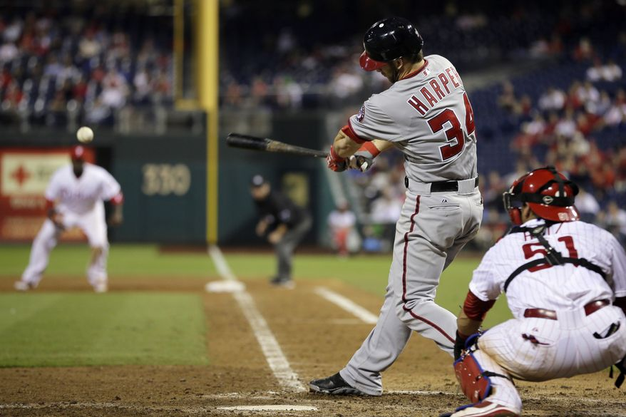 Bryce Harper hits an RBI-triple in the ninth inning Wednesday night. (Associated Press)