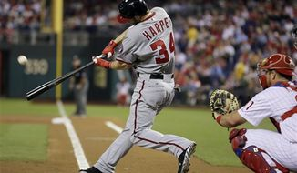 Washington Nationals' Bryce Harper hits a home run off Philadelphia Phillies starting pitcher Tyler Cloyd in the first inning of a baseball game, Thursday, Sept. 27, 2012, in Philadelphia. The Nationals won the game, 7-3. (Associated Press)