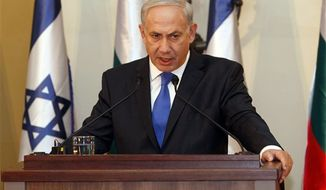 ** FILE ** In this Sept. 11, 2012, photo, Israeli Prime Minister Benjamin Netanyahu speaks during a joint press conference with his Bulgarian counterpart Boyko Borissov, not seen, in Jerusalem. Israeli Prime Minister Benjamin Netanyahu heads to the United Nations this week with a single item on his agenda: Iran. (AP Photo/Gali Tibbon, Pool, File)
