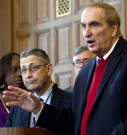 ** FILE ** New York Assemblyman Vito Lopez (right), Brooklyn Democrat, speaks during a news conference on affordable housing as Assembly Speaker Sheldon Silver (left), Manhattan Democrat, listens at the Capitol in Albany, N.Y., on Wednesday, April 18, 2012. (AP Photo/Mike Groll)