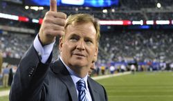 FILE - In this Sept. 5, 2012, file photo, Commissioner Roger Goodell gestures to fans before an NFL football game between the New York Giants and the Dallas Cowboys in East Rutherford, N.J. The NFL and referees' union reached a tentative agreement on Wednesday, Sept. 26, to end a three-month lockout that triggered a wave of frustration and anger over replacement officials and threatened to disrupt the rest of the season. (AP Photo/Bill Kostroun, File)