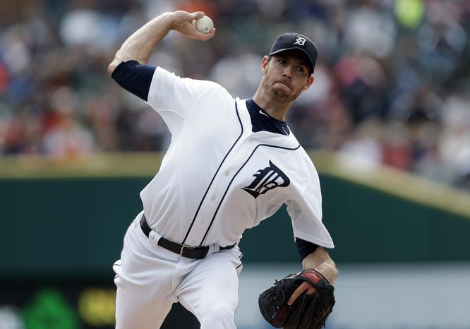Detroit Tigers starting pitcher Doug Fister throws against the Kansas City Royals in the first inning of a baseball game in Detroit, Thursday, Sept. 27, 2012.  (AP Photo