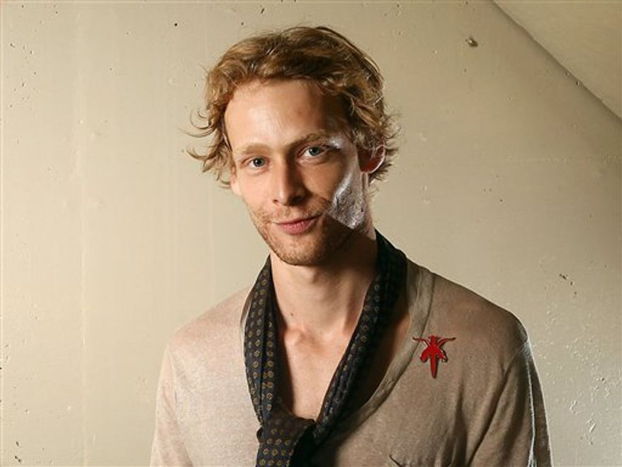 "** FILE ** This Sept. 14, 2011, file photo shows actor Johnny Lewis posing for a portrait during the 36th Toronto International Film Festival in Toronto, Canada. Authorities say Lewis fell to his death after killing an elderly Los Angeles woman. Lewis appeared in the FX television show ""Sons of Anarchy,"" for two seasons. The woman killed is identified as 81-year-old Catherine Davis. (AP Photo/Carlo Allegri, file)"