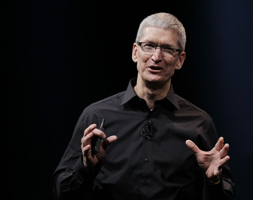 **FILE** Apple CEO Tim Cook speaks Sept. 12, 2012, during an introduction of the new iPhone 5 in San Francisco. (Associated Press)