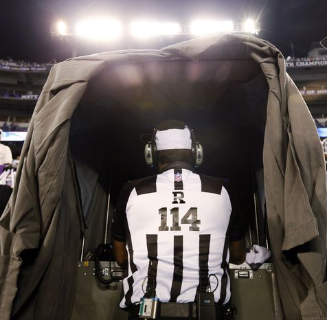 Referee Gene Steratore looks over the instant replay monitor Sept. 27, 2012, before the Baltimore Ravens-Cleveland Browns game in Baltimore. (Associated Press)