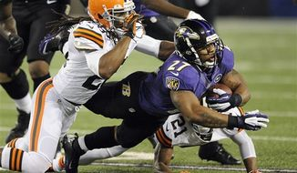 Baltimore Ravens running back Ray Rice (27) is stopped by Cleveland Browns free safety Usama Young (28) and cornerback Dimitri Patterson (21) during the first half of an NFL game in Baltimore, Thursday, Sept. 27, 2012. (AP Photo/Nick Wass)