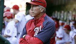 Washington Nationals manager Davey Johnson stands in the dugout during a baseball game against the Milwaukee Brewers at Nationals Park Monday, Sept. 24, 2012, in Washington. The Nationals won 12-2. (AP Photo/Alex Brandon)