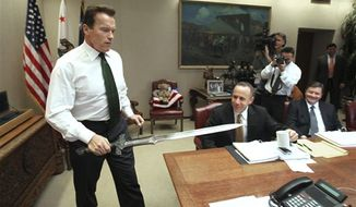 "** FILE ** In this Jan. 13, 2009, file photo, Gov. Arnold Schwarzenegger brings the sword he used in the movie ""Conan The Barbarian,"" to the conference table before the start of budget negotiations with legislative leaders at the Capitol in Sacramento, Calif. Schwarzenegger, who came to office during California's historic 2003 recall election, is releasing his autobiography, ""Total Recall: My Unbelievably True Life Story."" (AP Photo/Rich Pedroncelli, file)"