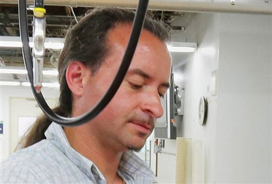 This July 2012 photo shows Andrew Engeldinger working at Accent Signage in Minneapolis. Minneapolis Police Chief Tim Dolan told a Friday, Sept. 28, 2012, news conference that the gunman in Thursday's attack inside a Minneapolis sign company where four people were killed was 36-year-old Engeldinger. Police also say that Engeldinger had been fired hours before the attack. (AP Photo/Finance and Commerce, Bill Klotz)