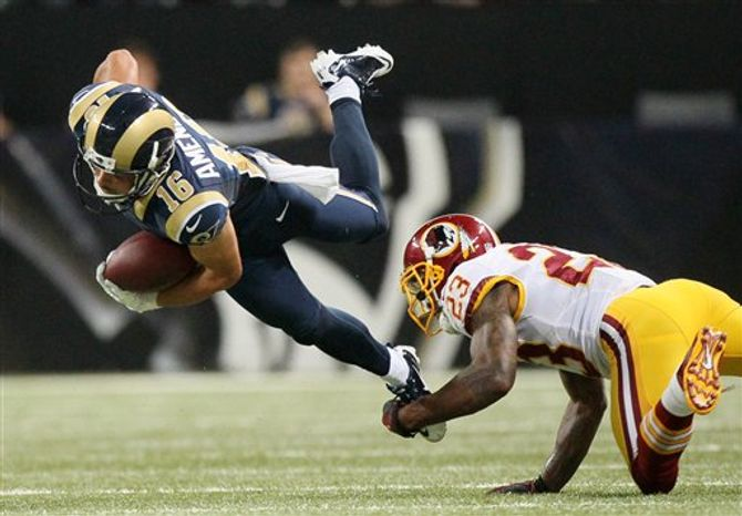 ** FILE ** St. Louis Rams wide receiver Danny Amendola (16) is tackled by Washington cornerback DeAngelo Hall after an eight-yard gain in second quarter action of an NFL football game on Sunday, Sept. 16, 2012, at the Edward Jones Dome in St. Louis. (AP Photo/St. Louis Post-Dispatch, Chris Lee)