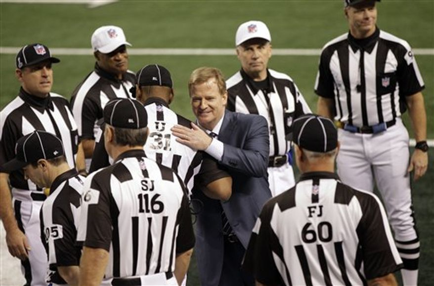 ** FILE ** In this Feb. 6, 2011, file photo, NFL commissioner Roger Goodell greets game officials before the Super Bowl XLV football game in Arlington, Texas. The NFL's regular officiating crews are back. (AP Photo/Marcio Jose Sanchez, File)