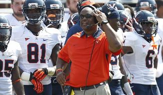 ** FILE ** Virginia head coach Mike London watches from the sideline during the second half on an NCAA college football game against TCU, Saturday, Sept. 22, 2012, in Fort Worth, Texas. TCU won 27-7, (AP Photo/LM Otero)