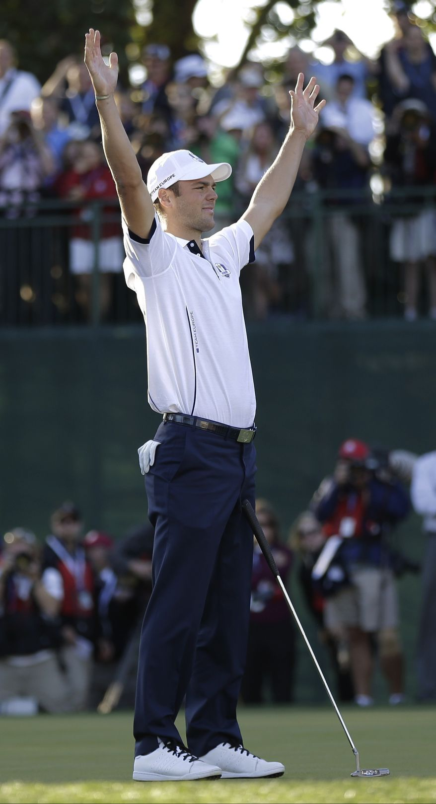 Europe's Martin Kaymer reacts after winning his match on the 18th hole to clinch a Europe win during a singles match at the Ryder Cup PGA golf tournament Sunday, Sept. 30, 2012, at the Medinah Country Club in Medinah, Ill. (AP Photo/David J. Phillip)