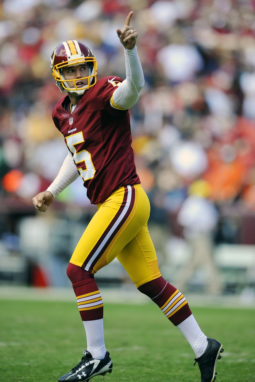 Washington Redskins kicker Billy Cundiff runs off the field during the first half of an NFL football game against the Cincinnati Bengals in Landover, Md., Sunday, Sept. 23, 2012. (AP Photo/Nick Wass)