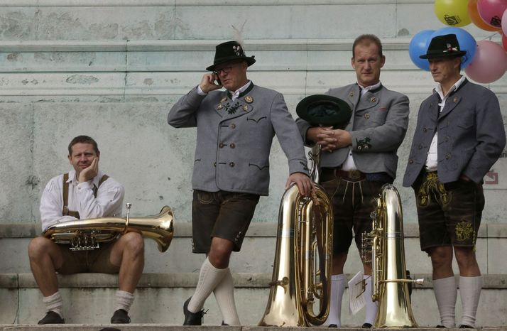 Musicians await the start of a band concert at the famous Oktoberfest beer festival in Munich on Sunday, Sept. 30, 2012. Held from Sept. 22 to Oct. 7, the Oktoberfest will see millions of visitors. (AP Photo/Matthias Schrader)
