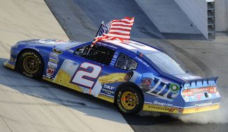 Brad Keselowski celebrates winning the NASCAR Sprint Cup Series auto race, Sunday, Sept. 30, 2012, at Dover International Speedway in Dover, Del. (AP Photo/Nick Wass)